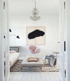 White living room with touches of black & pink