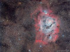 The large majestic Lagoon Nebula is home for many young stars and hot gas.