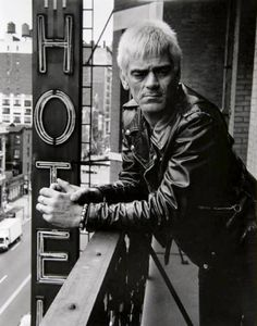 Artist: Rita Barros Title: Dee Dee Ramone at the Chelsea Hotel Year: 1992 Medium: Gelatin Silver Photograph, Signed and numbered in ink verso Edition: Size: 20 x 16 inches Ramones, Music Is Life, My Music, Hotel A New York, Fillmore East, Chelsea Hotel, Heartbreak Hotel, Dee Dee, Music Icon