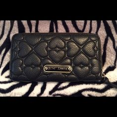 Betsey Johnson black heart wallet Black faux leather zip around wallet. In great condition 8card slots gold on the inside Betsey Johnson Bags Wallets