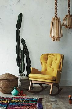 Eclectic, simple, boho decor.  I love the cactus and woven basket.