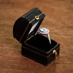A beautiful vintage style engagement ring in a box.