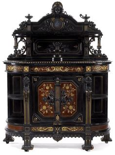 An American Renaissance Revival parcel-gilt, carved and ebonized cabinet. Herter Brothers, New York, c. 1872