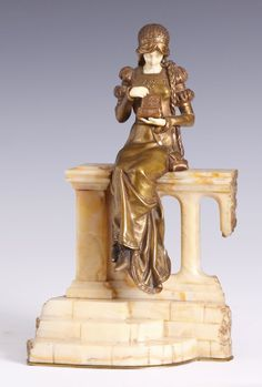 DOMINIQUE ALONZO,  SCULPTURE, 1908.  Bronze and ivory. Green onyx base. Young princess on a throne. Signed D. Alonzo. H 28.5 cm.
