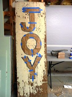 diy sign tutorial for JOY Like this for one side of the front door and old sled & skates on other side