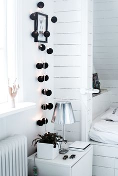 HOUSE of PHILIA: black hanging balls with small lights against the white interior looks really nice.