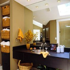 "Warm up a space by designing shelves to hold large basket ""drawers"" for towels and supplies. These can go in a vertical space like the one shown here, or try any open area under a sink or in an unused niche."