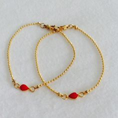 GOLD and red friendship bracelets ADORABLE,! 2 gold matching friendship bracelets with lobster clasp closure and a red center accent. Jewelry Bracelets