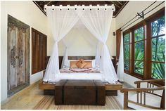 Bali style bedroom -Check out the doors!