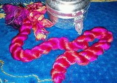 Hot pink and red orange silk thrum. Recycled sari silk fiber. Spin felt craft