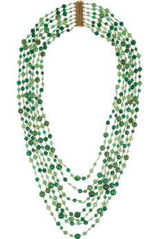 Rosantica's multi-strand necklace is hand-strung using carefully linked gold-dipped wire. Every green agate bead is faceted for a subtle sparkle. This statement piece fastens with a magnetic claps which is firmly secured with an additional hook.