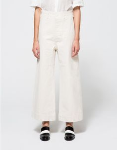 From Jesse Kamm, high wasted sailor pant in natural with allover subtle speckle.  Features button fly with top button, belt loops, front horizontal pockets, darted back, dropped crotch, wide leg, cropped length and relaxed fit through leg.   • High wast