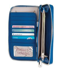 The perfect wallet...a place for everything and everything in its place! Credit cards, cash, change, cell phone!! Add a wristlet and you are out the door!