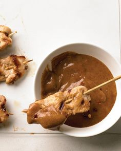 Chicken Satay Skewers - Be sure to use gluten-free soy sauce for these succulent skewers. They corroborate our theory that everything -- absolutely everything -- tastes better on a stick.