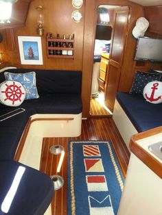 Signal Flag Rug with Navy fabric and nautical icons. And the DHR gimballed lamp on the wall.