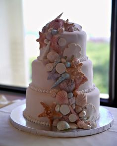 "Sea Shell wedding cake - This is my 2nd sea shell wedding cake.  Cake is rolled fondant with hand made/hand painted (very unique) sea shells.  They are turly life like. Size is a 6"", 8"", 10"" round cake."
