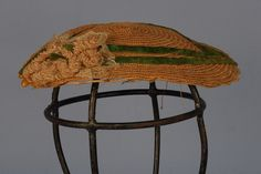 337: LADY'S INFORMAL HAT, 1860's. Fine leghorn straw with scalloped edge, decorated with twin bands of green velvet, a woven horsehair flower and lace. 9 x 6 3/4. (Lace damaged) otherwise excellent.: Lot 337