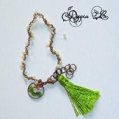 Bracelet à pampille et pompon tons vert