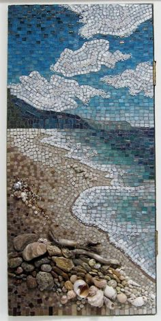 Landscape mosaic with a mixture of bizzaza glass tiles, ceramic tiles, stones, beads, shells and wood. Done on a bathroom cabinet door, note hinges on right side. Artist: Chris Gb, Perth, Western Australia.