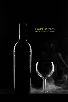 Wine Bottle with a smokey Glass    GAPO studios for Graphic design & Commercial/Fashion Photography.  2012 © All Rights Reserved