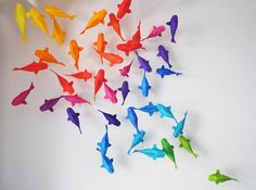 Origami fish, swimming on a wall.