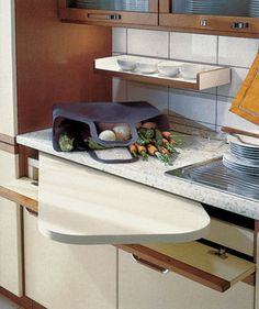 Space saving hidden cutting board or extra counter great idea for a tiny kitchen from design . image extra counter space for kitchen Tiny House Furniture, Home Furniture, Kitchen Furniture, Tiny Spaces, Small Apartments, New Kitchen, Kitchen Decor, Kitchen Ideas, Kitchen Small