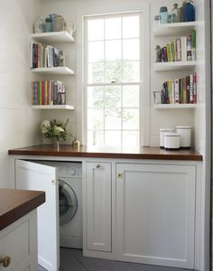 Laundry room with washer & dryer hidden behind cabinet doors - Olivia Brock, Lacquered Life