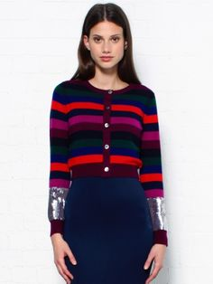 Markus Lupfer Striped Cropped Cardigan. This cropped striped cardigan is the perfect wardrobe sweater this autumn integrating two key season trends into one piece- burgundy colours and crops, without the chill! Wear this fun Markus Lupfer cardigan buttoned up with high waisted indigo jeans or toughen it up with some leather. The sequined cuff detailing adds glamour and fun. With extra comfort due to the 100% Merino Wool with ribbed cuffs, hemline and neckline, you won't want to take it off!