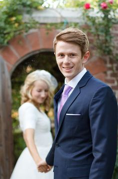 Dan accessorized his navy suit with a light purple tie.