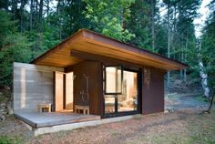This is a 191 sq. ft. modern cabin designed by Olson Kundig. It's located off the coast of Vancouver Island, British Columbia, Canada. You'll notice a large weathered steel clad panel d…