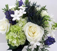 Bridal bouquet for a Scottish wedding. Includes thistle.