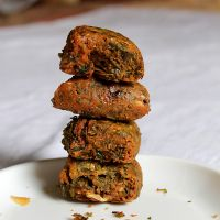 Kothimbir Vadi – Coriander Fritters: 2 ounces fresh coriander leaves, 2 cups sifted chick-pea flour, 2 cups plain yogurt, 1 or 2 fresh chilies chopped, 3 teaspoons salt, 1 3/4 cups water, ghee (clarified butter) or vegetable oil for deep-frying