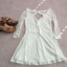 White lace dress NEVER WORN NEVER WORN white lace dress with small oval cutout on back and 3 button fasten on neck for secure fit. So cute for summer events and can be dressed up with boots for cooler days. The lace does not itch and fits true to size American Eagle Outfitters Dresses