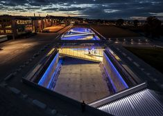 BIG has completed the Danish National Maritime Museum, an underground museum that loops around an old dry dock in Helsingør, Denmark. Innovative Architecture, Museum Architecture, Concept Architecture, Amazing Architecture, Modern Architecture, Helsingor, Facade Lighting, Exterior Lighting, Bjarke Ingels Architecture