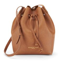 Been looking for a sleek yet simple bucket bag love the cognac color but would love it equally in wine