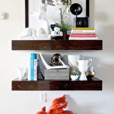 Light and bright styled staircase landing shelves complete with a styling animation so you can see how it's done!