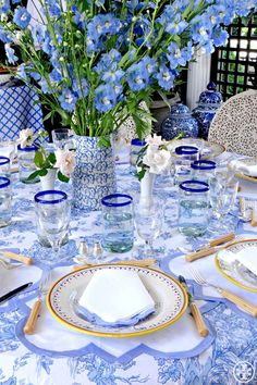 Wedgewood Blue China Pattern as the place setting of the spring table with pretty blue delphinium as the centerpiece and eclectic mix of glassware and silverware