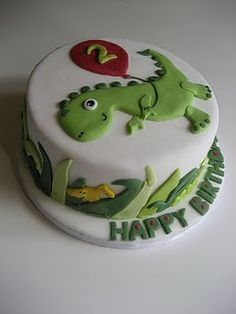 cute dino cake, lil dino with baloon saying four and bottom saying happy birthday gabe