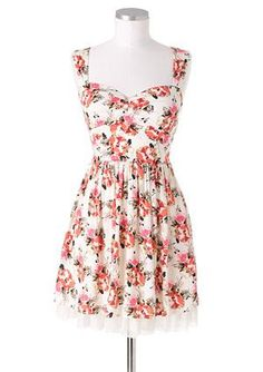 this dress is the ideal summer dress. adorable cut and pretty colors.