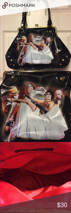 Rock Rebel Rock Horror Picture Show Purse This Rocky Horror Picture Show Purse is by Rock Rebel, It well loved, but still in good condition.  It's a kiss lock and it may not seem this way, but it can hold a lot! Bags