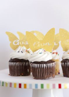 Personalized butterfly cupcake toppers, perfect for a garden themed party.  Click on the photo to shop at Melinda Bryant Party Boutique on Etsy.  // party supplies, butterfly party, girls birthday party ideas, glitter, #melindabryantphoto, party decorations, tea party #butterflybirthdayparty #kidspartyideas #partyplanning