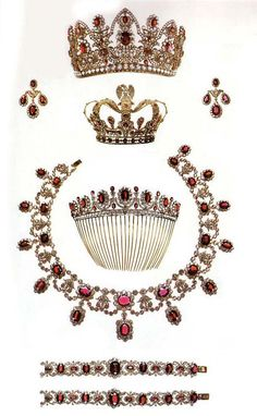 This ruby parure was made for the empress Marie Louise (1791-1847) by François-Regnault Nitot in 1811 at Paris. Gold, diamonds and rubies. The crown Is worn at the top of the head and stopped with a brooch. The height is 10 cm and the diameter is 14,4 cm. http://www.theroyalforums.com/forums/f233/crowns-and-royal-regalia-1428-5.html#post1696460