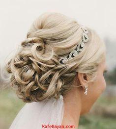 Beautiful-Wedding-Updo-With-Crystal-Headband-and-Veil