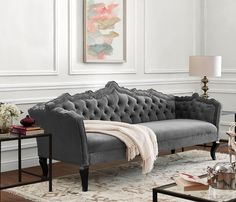 The classically elegant Brooks sofa boasts a marvelous hand carved frame design and individually hand-applied silver nail head trim. The luxurious button tufting and curved legs assure that this velve