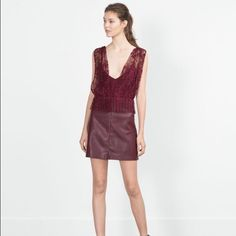 Zara Lace Leather Dress This dress is a gorgeous mix of a sheet lace overlay plunge top and a funky faux leather skirt. It is a deep burgundy. So unique and flattering! Never worn with tags! Zara Dresses Mini