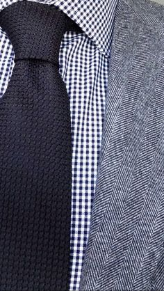 Light grey tweed jacket, navy gingham shirt, navy tie