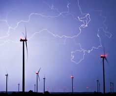Flashlights light the sky over a wind energy park during a thunderstorm near Jacobsdorf, eastern Germany, Thursday, May 9, 2013. (Patrick Pleul/dpa/AP)