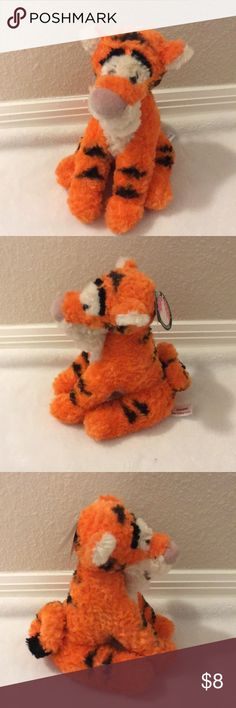 Brand new Tigger plush This is a brand new stuffed animal from Disney. No marks or stains Disney Other