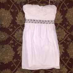 White dress. NEVER BEEN WORN. New dress, with pretty detailing around the dress! The dress is a medium but 100% fits like a small! MM Couture Dresses Strapless