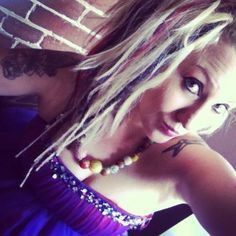 Undercut DIY hairstyles with synthetic colored dreads and colored extensions. Awesome hair. Half shaved hairstyles. Pink, black, blonde
